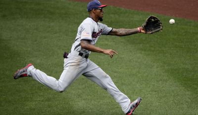 Minnesota Twins center fielder Byron Buxton chases down an RBI double hit by Kansas City Royals' Alcides Escobar during the fourth inning of a baseball game, Sunday, July 2, 2017, in Kansas City, Mo. (AP Photo/Charlie Riedel)