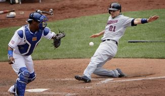 Minnesota Twins' Jason Castro (21) beats the tag by Kansas City Royals catcher Salvador Perez to score on a single by Brian Dozier during the fifth inning of a baseball game, Sunday, July 2, 2017, in Kansas City, Mo. (AP Photo/Charlie Riedel)