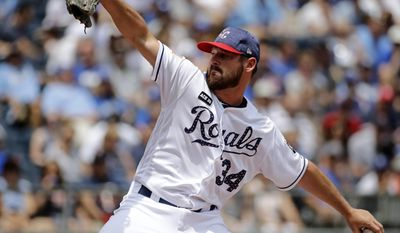 Kansas City Royals pitcher Travis Wood throws during the first inning of a baseball game against the Minnesota Twins, Sunday, July 2, 2017, in Kansas City, Mo. (AP Photo/Charlie Riedel)