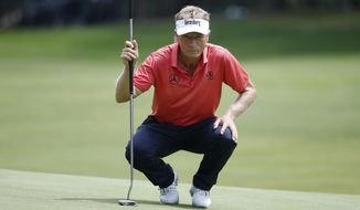 Bernhard Langer, of Germany, reads the green on the second hole during the third round of the U.S. Senior Open golf tournament, Saturday, July 1, 2017, in Peabody, Mass. (AP Photo/Michael Dwyer)