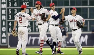 Houston Astros' Alex Bregman (2), Jake Marisnick (6), Carlos Correa (1) and Norichika Aoki (3) celebrate after a baseball game against the New York Yankees, Sunday, July 2, 2017, in Houston. (AP Photo/David J. Phillip)