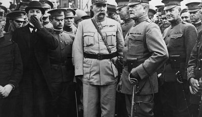 General John J. Pershing, commander of the American expenditionary forces, seen with American and French officers, arrives in France with a group of American officers, June 13, 1917.  He had just stepped off the ship at Boulogne.  French officer at center is Gen. Pelletier (first name unavailable), with Gen. Pershing at his right and Maj. Gen. James Harbord to right of Pershing.  (AP Photo)