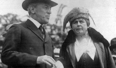 U.S. President Woodrow Wilson and wife, first lady Edith Bolling Wilson attend the opening of the airplane mail service, May 15, 1918, in Washington, D.C. (AP Photo)