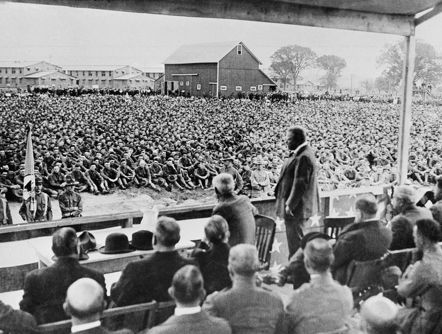 Former President Theodore Roosevelt is shown addressing 29,000 soldiers in a training camp during World War I before they left for France.    The date and location of photo is not given, photo is circa 1917-1918.     (AP Photo)