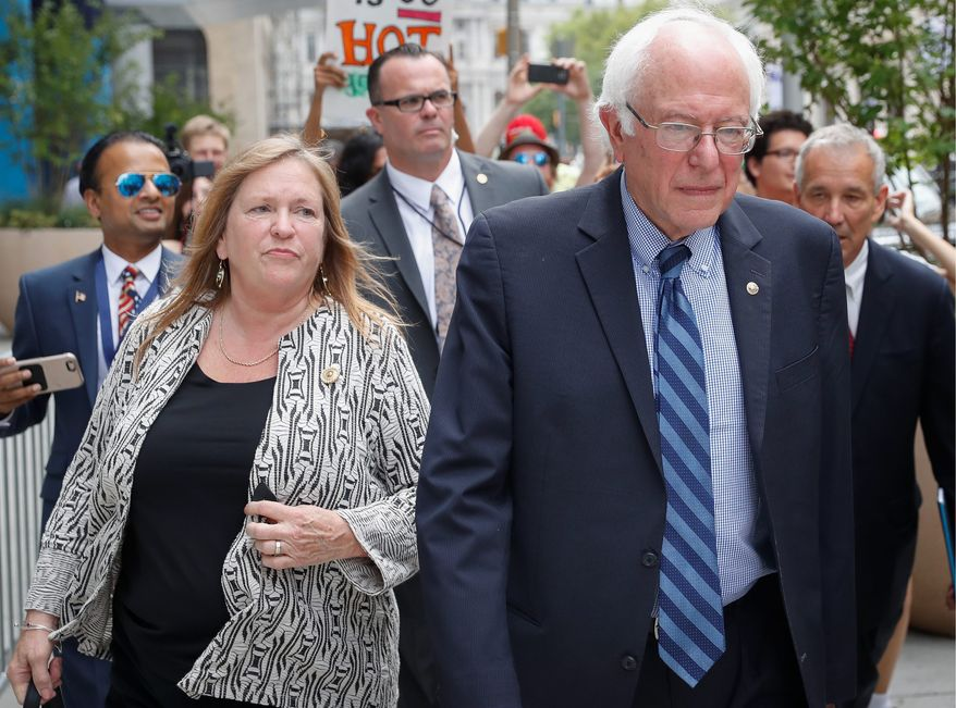Sen. Bernard Sanders and wife Jane O'Meara Sanders hired lawyers in light of investigations into the finances of now-defunct Burlington College, which closed last year due, some believe, to debts incurred during Mrs. Sanders' tenure. (ASSOCIATED PRESS)