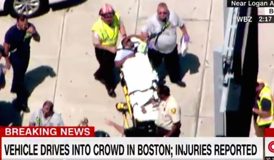 Emergency crews attend to injured pedestrians on Monday, July 3, 2017, in East Boston. A 56-year-old cab driver's vehicle plowed into the group near Logan Airport. (CNN screenshot)