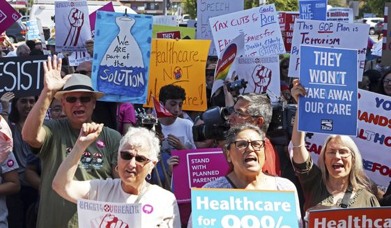 Doctors, nurses, health care workers and patients who will lose access to health care or see costs rise attend a rally against the GOP health care bill at Harbor-UCLA Medical Center in Torrance, Calif., Monday, July 3, 2017. (AP Photo/Reed Saxon)