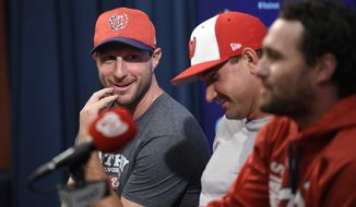 Washington Nationals All-Stars from left to right, Max Scherzer, Ryan Zimmerman and Daniel Murphy react during a press conference before a baseball game against the New York Mets, Monday, July 3, 2017, in Washington. (AP Photo/Nick Wass)