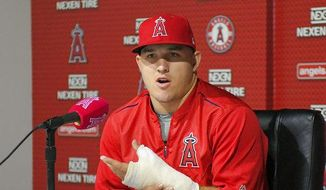 FILE - In this June 3, 2017, file photo, Los Angeles Angels' Mike Trout speaks about his injured left thumb during a news conference prior to the team's baseball game against the Detroit Tigers in Anaheim, Calif. American League MVP Trout will miss the All-Star Game while rehabilitating the thumb. (AP Photo/Mark J. Terrill, File)