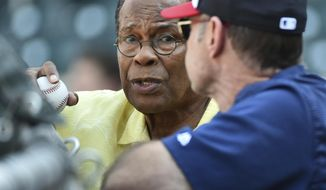 Hall of Fame player Rod Carew, left, talks with Minnesota Twins manager Paul Monitor during batting practice before a baseball game, Monday July 3, 2017, in Minneapolis. (AP Photo/John Autey)