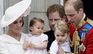 FILE - In this Saturday, June 11, 2016 file photo, Britain's Prince William holding Prince George, right and Kate, Duchess of Cambridge holding Princess Charlotte, left, on the balcony during the Trooping The Colour parade at Buckingham Palace, in London. Kensington Palace says in a statement Monday, July 3, 2017, the Duke and Duchess of Cambridge will take Prince George and Princess Charlotte along when they tour Germany and Poland.  (AP Photo/Tim Ireland, File)