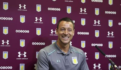 "New Aston Villa signing John Terry, reacts during the media conference at Villa Park, Birmingham, England, Monday July 3, 2017.  Former England and Chelsea captain John Terry has signed a one-year deal with second-division Aston Villa, saying he is ""delighted"" and is looking to ""help the squad achieve something special this season.""(Aaron Chown/PA via AP)"