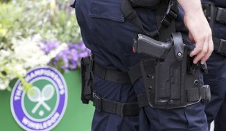 Armed police are seen on day one at the Wimbledon Tennis Championships in London Monday, July 3, 2017. (AP Photo/Tim Ireland)