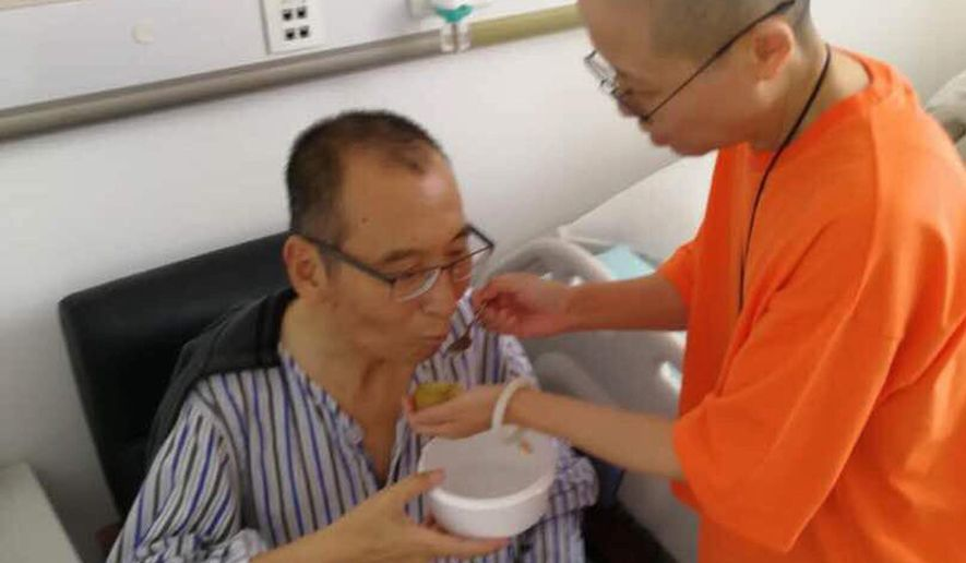 In this recent undated handout photo, Chinese dissident and Nobel Prize laureate Liu Xiaobo, left, is attended to by his wife Liu Xia in a hospital in China. Liu Xiaobo has been released from prison on medical parole after being diagnosed earlier June 2017 with late-stage liver cancer and is being treated in a hospital in the northeastern city of Shenyang. He had been more than half-way through an 11-year sentence after being convicted in 2009 on subversion charges. (Photo via AP)