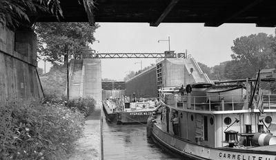 FILE - In this Sept. 4, 1947 file photo, an oil-loaded barge is pushed into lock two near Waterford, N.Y., as it starts its westward journey on the Erie Canal. Ground was broken for the Erie Canal 200 years ago, and when the 363-mile canal fully opened in 1825, it was the greatest engineering feat of the era and one that would change history. (AP Photo, File)