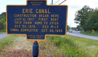 In this June 28, 2017, photo, a sign on route 49/46 in Rome, N.Y., marks the spot where digging for construction on the Erie Canal began. This Fourth of July marks the 200th anniversary of the ceremonial first digging for the construction of the Erie Canal, a 363-mile waterway that would change history. (John Clifford/The Daily Sentinel via AP)