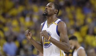 FILE - In this June 12, 2017 file photo, Golden State Warriors forward Kevin Durant reacts after scoring against the Cleveland Cavaliers during the second half of Game 5 of basketball's NBA Finals in Oakland, Calif. A person with knowledge of the situation tells The Associated Press that Durant has agreed to terms on a two-year deal worth about $53 million to remain with the Golden State Warriors. The deal calls for about $25 million in the first year with a player option for the second season. The person spoke on condition of anonymity because the contract cannot be signed until Thursday, July 6, 2017. (AP Photo/Marcio Jose Sanchez, File)