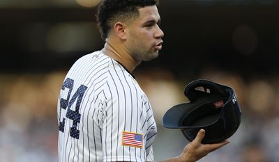 New York Yankees' Gary Sanchez removes his helmet while waiting out a mound conference during the first inning of baseball game against the Toronto Blue Jays in New York, Monday, July 3, 2017. Sanchez and the Yankees Aaron Judge, who lead the Yankees' offense, will participate in the All-Star Home Run Derby July 10 in Miami it was announced Monday. (AP Photo/Kathy Willens)