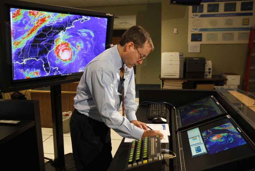 FILE - In this Sept. 2, 2010, file photo, Chief hurricane forecaster James Franklin prepares for a live update on Hurricane Earl at the National Hurricane Center in Miami. Franklin, a retiring chief of the hurricane specialist unit at the National Hurricane Center in Miami says further cuts to tropical weather research threaten to undermine recent improvements in hurricane intensity forecasts. (AP Photo/Lynne Sladky, File)