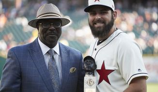 """Detroit Tigers starting pitcher Michael Fulmer, right, receives the """"Larry Doby Legacy Award for American League Rookie of the Year"""" award from Bob Kendrick, president of the Negro Leagues Baseball Museum, prior to the second baseball game of a doubleheader against the Cleveland Indians in Detroit, Saturday, July 1, 2017. (AP Photo/Rick Osentoski)"""