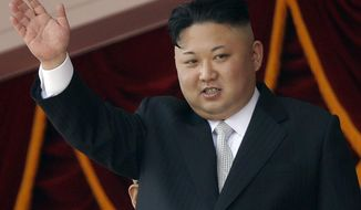 FILE - In this April 15, 2017 file photo, North Korean leader Kim Jong Un waves during a military parade in Pyongyang, North Korea to celebrate the 105th birth anniversary of Kim Il Sung, the country's late founder and grandfather of current ruler Kim Jong Un. South Korea's military said Tuesday, July 4, 2017 North Korea has launched another ballistic missile. The launch is part of a string of test-firings in recent months as the North works to build a nuclear-tipped missile that could reach the United States. (AP Photo/Wong Maye-E, File)