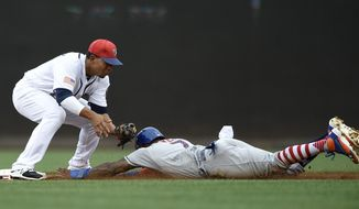 New York Mets' Jose Reyes, right, is out trying to steal second against Washington Nationals shortstop Adrian Sanchez, left, during the third inning of a baseball game, Monday, July 3, 2017, in Washington. (AP Photo/Nick Wass)