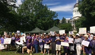 Maine's government shutdown entered its third day on Monday, July 3, 2017, as union members hold a rally across from the Maine State House in Augusta, Maine. (AP Photo/Patrick Whittle)