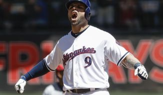 Milwaukee Brewers' Manny Pina reacts after hitting a two-run scoring double during the second inning of a baseball game against the Baltimore Orioles Monday, July 3, 2017, in Milwaukee. (AP Photo/Morry Gash)