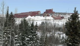 FILE - In this Feb. 10, 2016, file photo the closed LTV Steel taconite plant is seen near Hoyt Lakes, Minn. The prospect remains of returning the site, which was closed in 2000, to operation as part of Minnesota's first copper-nickel mine owned by PolyMet. U.S. Rep. Rick Nolan has introduced a bill to force completion of a land swap needed for the proposed PolyMet mine. (AP Photo/Jim Mone)