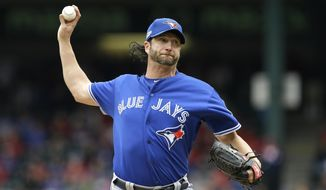 FILE - In this Oct. 7, 2016 file photo, Toronto Blue Jays pitcher Jason Grilli throws against the Texas Rangers in the seventh inning of Game 2 of baseball's American League Division Series, in Arlington, Texas. Grilli has joined the Texas Rangers, giving them a veteran presence in a struggling bullpen. Grilli was added the roster Monday, July 3, 2017, a day after Texas acquired him in a trade from the Toronto Blue Jays. (AP Photo/LM Otero, File)