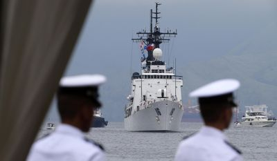 FILE - In this Aug. 6, 2013, file photo, the BRP Ramon Alcaraz, the second warship of the Philippine Navy, prepares to dock for a formal welcoming ceremony at Subic Freeport, about 80 kilometers (50 miles) northwest of Manila, Philippines. U.S. and Philippine navy ships have patrolled waters in the southern Philippines where kidnappings by ransom-seeking Abu Sayyaf militants have sparked a regional security alarm. U.S. Navy Lt. Cmdr. Arlo Abrahamson said a Navy combat ship, the USS Coronado, and the Philippine Navy frigate BRP Ramon Alcaraz completed the four-day patrol at the Sulu Sea on Saturday, July 1, 2017, adding that the operation was carried out at the request of the Philippine government. (AP Photo/Bullit Marquez, File)