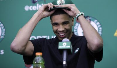 FILE - This June 23, 2017 file photo shows Boston Celtics first-round draft pick Jayson Tatum at the team's practice facility in Waltham, Mass. NBA Summer League rosters are typically full of rookies getting their first taste of the league or other players young in their career trying to catch on with a roster. The Utah Summer League will open with the most anticipated game of the three-day session. The 76ers and No. 1 pick Markelle Fultz face Tatum and the Celtics in the first game Monday. (AP Photo/Charles Krupa, file)