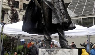 A statue of William Seward is unveiled in a plaza across from the Alaska state Capitol on Monday, July 3, 2017, in Juneau, Alaska. The statue commemorates the 150th anniversary of the agreement under which the U.S. bought the territory of Alaska from Russia. As Secretary of State in 1867, Steward signed and helped negotiate the Treaty of Cession with Russia. (AP Photo/Becky Bohrer)