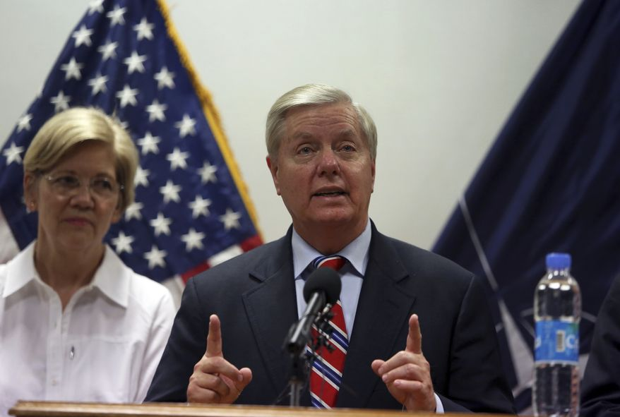 U.S. Sen. Lindsey Graham right, speaks during a press conference at the Resolute Support headquarters in Kabul, Afghanistan, Tuesday, July 4, 2017. Sen. Elizabeth Warren is seen left. (AP Photo/Rahmat Gul) ** FILE **