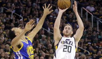 FILE - In this May 6, 2017, file photo, Utah Jazz forward Gordon Hayward (20) shoots as Golden State Warriors guard Shaun Livingston (34) defends in the second half during Game 3 of the NBA basketball second-round playoff series in Salt Lake City. Hayward has chosen to sign with the Boston Celtics and reunite with coach Brad Stevens, making the announcement Tuesday evening, July 4, on The Players' Tribune site. (AP Photo/Rick Bowmer, File)