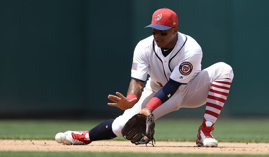 Washington Nationals shortstop Wilmer Difo (1) fields a ball during a baseball game against the New York Mets, Tuesday, July 4, 2017, in Washington. The Nationals won 11-4. (AP Photo/Nick Wass)