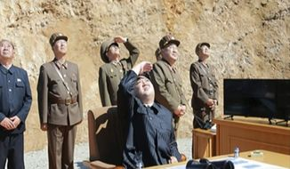 This image made from video of a news bulletin aired by North Korea's KRT on Tuesday, July 4, 2017, shows what was said to be North Korea leader Kim Jung Un, center, watching the launch of a Hwasong-14 intercontinental ballistic missile, ICBM, in North Korea's northwest. Independent journalists were not given access to cover the event depicted in this photo. North Korea claimed to have tested its first intercontinental ballistic missile in a launch Tuesday, a potential game-changing development in its push to militarily challenge Washington  but a declaration that conflicts with earlier South Korean and U.S. assessments that it had an intermediate range. (KRT via AP Video)