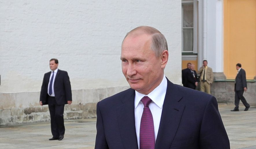 Russian President Vladimir Putin walks in the Kremlin in Moscow, Russia, Tuesday, July 4, 2017. (Mikhail Klimentyev/Sputnik, Kremlin Pool Photo via AP)