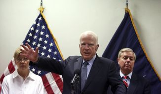 U.S. Senator John McCain, center, speaks during a press conference at the Resolute Support headquarters in Kabul, Afghanistan, Tuesday, July 4, 2017. Senators Elizabeth Warren, left, and Lindsey Graham are seen in the background.  (AP Photo/Rahmat Gul)
