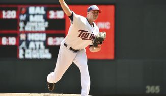 Minnesota Twins starter Kyle Gibson delivers a pitch to the Los Angeles Angels in the first inning of a baseball game, Tuesday July 4, 2017, in Minneapolis. (AP Photo/John Autey)