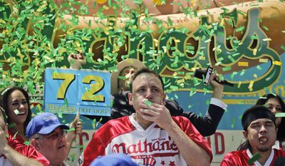 Joey Chestnut wins the Nathan's Famous Hot Dog Eating Contest, marking his 10th victory in the event, Tuesday, July 4, 2017, in the Brooklyn borough of New York. He downed 72 hot dogs and buns in 10 minutes. (AP Photo/Bebeto Matthews)