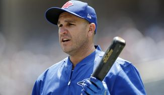 Toronto Blue Jays' Miguel Montero holds a bat between turns in the batting cage before a baseball game against the New York Yankees at Yankee Stadium in New York, Tuesday, July 4, 2017. The Blue Jays acquired Montero from the Chicago Cubs for a player to be named later or cash considerations after designating him for assignment less than 24 hours after he blamed pitcher Jake Arrieta for the seven stolen bases Chicago allowed against the Washington Nationals. (AP Photo/Kathy Willens)