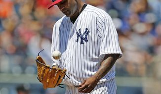 New York Yankees starting pitcher CC Sabathia tosses the ball up after allowing a two-run single to Toronto Blue Jays'  Kendrys Morales during the third inning of a baseball game in New York, Tuesday, July 4, 2017. Yankees manager Joe Girardi removed Sabathia after he allowed four runs in two and two-thirds innings. (AP Photo/Kathy Willens)