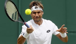 Spain's David Ferrer returns to Richard Gasquet of France during their Men's Singles Match on day two at the Wimbledon Tennis Championships in London Tuesday, July 4, 2017. (AP Photo/Kirsty Wigglesworth)