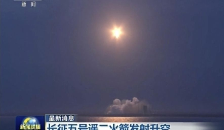 "In this image taken from video footage run by China's CCTV via AP Video, a Long March 5 rocket lifts off from the Wenchang Space Launch Center in southern China's Hainan province on Sunday, July 2, 2017. Authorities say the Long March-5 Y2 launched Sunday had an abnormality during the flight after what appeared to be a successful liftoff. The failure of the Long March 5 rocket deals a rare setback to China's highly successful space program, one that will almost certainly delay plans to send a spacecraft to bring back samples from the moon later this year, along with other upcoming missions. Chinese characters at both reads ""Long March-5 Y2 rocket life off."" (CCTV via AP Video)"