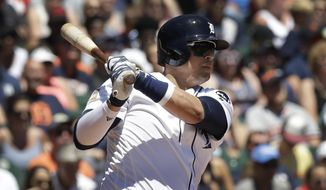 Detroit Tigers designated hitter Victor Martinez watches his RBI single to right during the fourth inning of a baseball game against the San Francisco Giants, Tuesday, July 4, 2017, in Detroit. (AP Photo/Carlos Osorio)