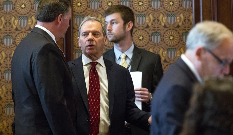 Senate President John Cullerton, D-Chicago, second from left, speaks with Senate Minority Leader Bill Brady, R-Bloomington on Tuesday, July 4, 2017, on the Senate floor at the Capitol in Springfield, Ill. The Illinois Senate has OK'd an annual spending plan of $36 billion following a critical vote to raise the income tax rate. If approved by Republican Gov. Bruce Rauner, it would be Illinois' first budget in more than two years. (Rich Saal/The State Journal-Register via AP)