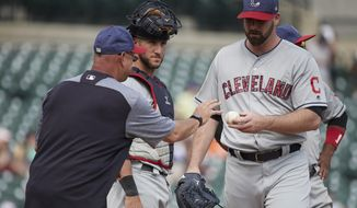 Cleveland Indians manager Terry Francona, left, takes the ball to relieve relief pitcher Boone Logan, right, as catcher Yan Gomes, center, looks on in the ninth inning of a baseball game against the Detroit Tigers in Detroit, Sunday, July 2, 2017. Cleveland won 11- 8. (AP Photo/Rick Osentoski)