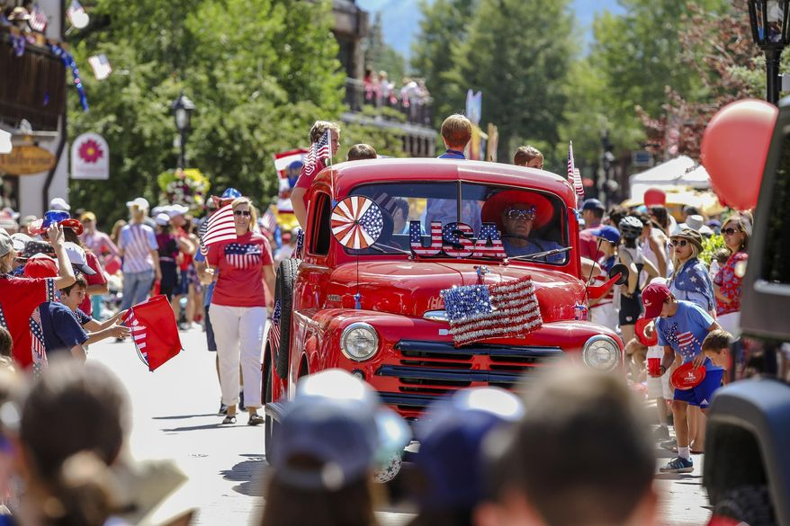 People watch an Independence Day parade on Tuesday, July 4, 2017, in Vail, Colo. (Chris Dillmann/Vail Daily via AP)
