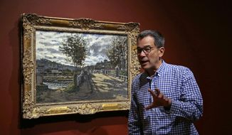 "In this June 29, 2017 photo, Director of Currier Museum of Art, Alan Chong, speaks about Claude Monet's 1869 painting, ""The Bridge at Bougival"" in the galley in Manchester, N.H. The beloved Monet painting along with three of his others show the artist's evolution in ""Monet: Pathways to Impressionism"" which opened on July 1. (AP Photo/Elise Amendola)"